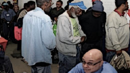Homeless people in line at a job fair.