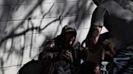 A homeless man accepts food.