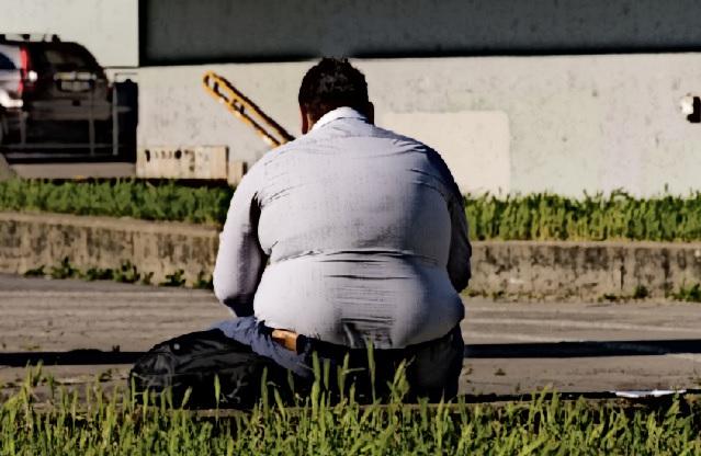 An overweight homeless man.
