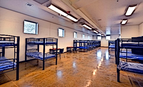 A homeless shelter with bunk beds.