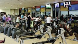People exercise in a fitness gym.