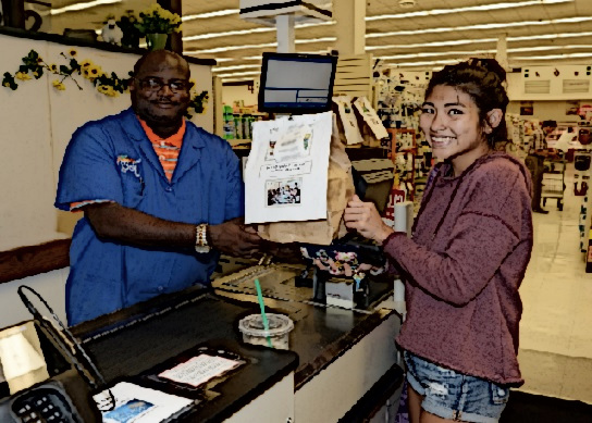 A woman shows her EBT groceries at a checkout counter.