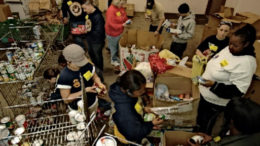 Employees sort food in a food pantry.